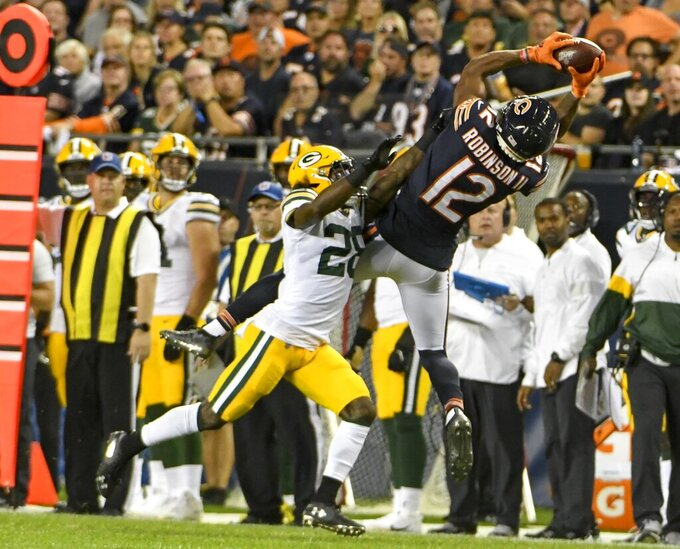 Chicago Bears' Allen Robinson catches a pass in front of Green Bay Packers' Tony Brown during the first half of an NFL football game Thursday, Sept. 5, 2019, in Chicago. (AP Photo/David Banks)