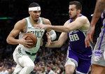 Boston Celtics forward Jayson Tatum, left, drives against Sacramento Kings forward Nemanja Bjelica (88) in the first half of an NBA basketball game, Thursday, March 14, 2019, in Boston. (AP Photo/Elise Amendola)