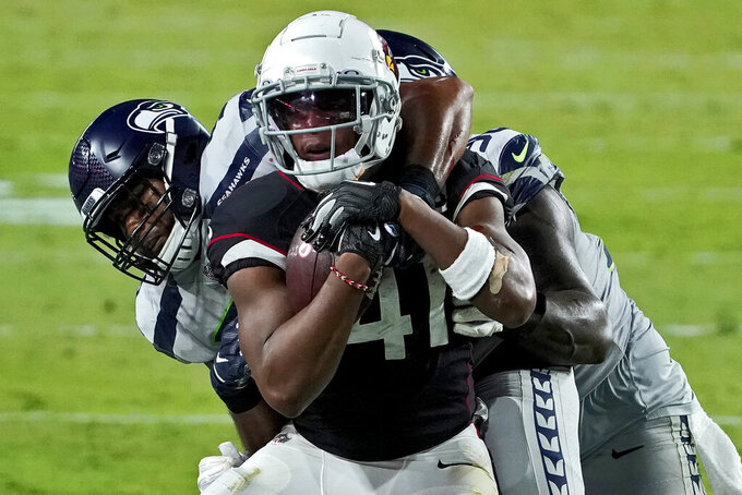 Arizona Cardinals running back Kenyan Drake (41) is tackled by Seattle Seahawks outside linebacker K.J. Wright during the second half of an NFL football game, Sunday, Oct. 25, 2020, in Glendale, Ariz. (AP Photo/Rick Scuteri)