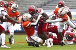 North Carolina State running back Zonovan Knight is tackled by Virginia defenders during an NCAA college football game, Saturday, Oct. 10, 2020, at Scott Stadium in Charlottesville, Va. (Erin Edgerton/The Daily Progress via AP)