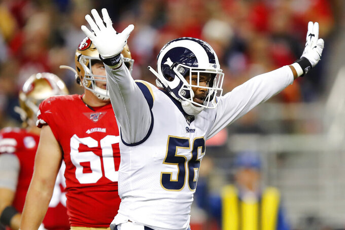 Los Angeles Rams linebacker Dante Fowler Jr. (56) raises his arms after sacking San Francisco 49ers quarterback Jimmy Garoppolo during the second half of an NFL football game in Santa Clara, Calif., Saturday, Dec. 21, 2019. (AP Photo/John Hefti)