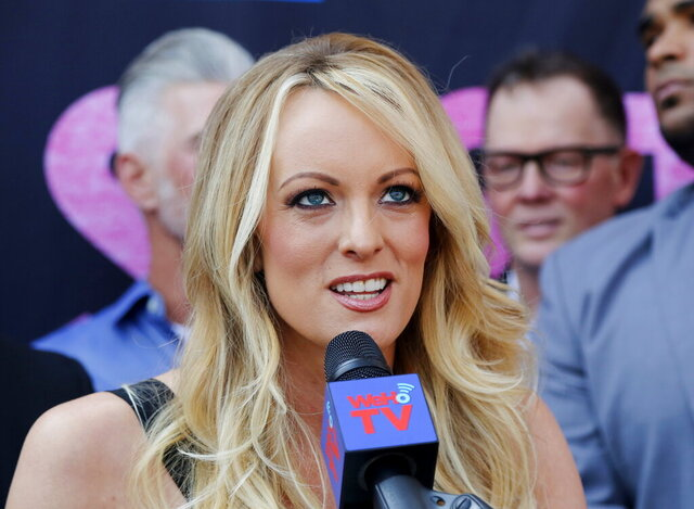 FILE - In this May 23, 2018, file photo, Stormy Daniels speaks during a ceremony for her receiving a City Proclamation and Key to the City in West Hollywood, Calif. A California court has ordered President Donald Trump to pay $44,100 in attorney fees to porn actress Stormy Daniels. The money is to pay for her legal battle to cancel a hush money deal to stay quiet about their sexual relationship a decade ago. (AP Photo/Ringo H.W. Chiu, File)