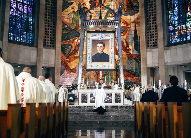 In this photo provided by the Archdiocese of Hartford, a tapestry showing Rev. Michael McGivney hangs above the alter at the Cathedral of St. Joseph in Hartford, Conn, Saturday, Oct. 31, 2020. The late Connecticut priest who founded the Knights of Columbus moved a step closer to possible sainthood with his beatification Saturday, as authorized by Pope Francis. (Archdiocese of Hartford via AP)