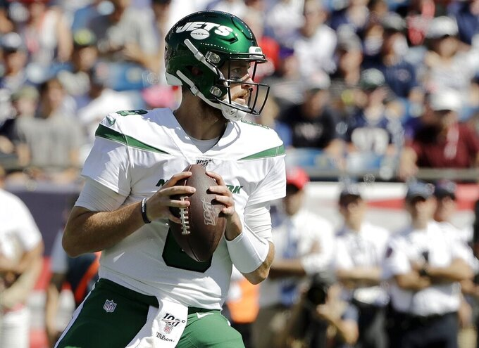 New York Jets quarterback Luke Falk drops back to pass against the New England Patriots in the first half of an NFL football game, Sunday, Sept. 22, 2019, in Foxborough, Mass. (AP Photo/Steven Senne)