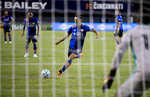 FC Cincinnati forward Yuya Kubo (7) scores a goal on a penalty kick against the Columbus Crew during the first half of an MLS soccer match Wednesday, Oct. 14, 2020, in Cincinnati. (Albert Cesare/The Cincinnati Enquirer via AP)