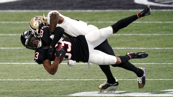 New Orleans Saints strong safety Malcolm Jenkins (27) hits Atlanta Falcons wide receiver Russell Gage (83) during the first half of an NFL football game, Sunday, Dec. 6, 2020, in Atlanta. (AP Photo/Brynn Anderson)