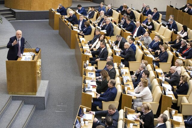 Pavel Krasheninnikov, lawmaker and co-chair of the constitutional reform working group speaks during a session at the Russian State Duma, the Lower House of the Russian Parliamentin Moscow, Russia, Thursday, Jan. 23, 2020. The Russian lower house of parliament, the State Duma, holds the first of three readings and a vote on a draft bill on constitutional proposals put forward by the Kremlin. The package of constitutional amendments is widely seen as an attempt to secure President Vladimir Putin's grip on power well after his current term ends in 2024. (AP Photo/Alexander Zemlianichenko)