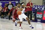 TCU guard RJ Nembhard (22) comes away with a steal as Oklahoma guard De'Vion Harmon, rear, pursues in the second half of an NCAA college basketball game in Fort Worth, Texas, Sunday, Dec. 6, 2020. (AP Photo/Tony Gutierrez)