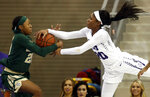 Baylor guard Juicy Landrum (20) and TCU guard Lauren Heard (20) fight for possession during the first half of an NCAA college basketball game Saturday, Jan. 12, 2019, in Fort Worth, Texas. (AP Photo/Ron Jenkins)