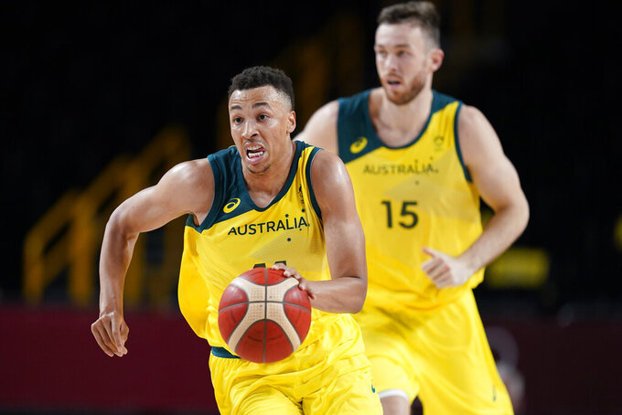Australia's Dante Exum drives up court during a men's basketball preliminary round game against Nigeria at the 2020 Summer Olympics, Sunday, July 25, 2021, in Saitama, Japan. (AP Photo/Charlie Neibergall)