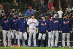 Houston Astros starting pitcher Zack Greinke (21) waits with teammates to share congratulations with players coming off the field after the the Astros' 3-0 win in a baseball game against the Seattle Mariners on Wednesday, Sept. 25, 2019, in Seattle. Greinke took a no-hitter into the ninth inning. (AP Photo/Elaine Thompson)