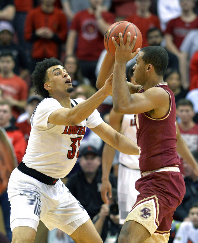 Louisville forward Jordan Nwora (33) attempts to strip the ball away from Boston College forward Steffon Mitchell (41) during the second half of an NCAA college basketball game in Louisville, Ky., Wednesday, Jan. 16, 2019. Louisville won 80-70. (AP Photo/Timothy D. Easley)