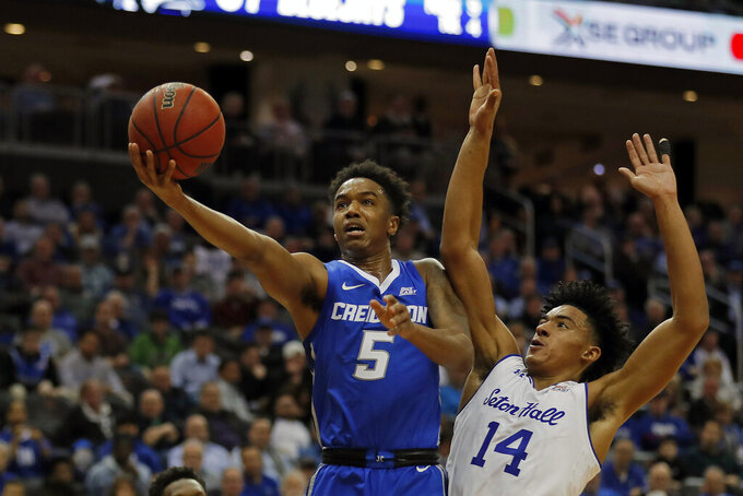 Creighton guard Ty-Shon Alexander (5) drives to the basket past Seton Hall guard Jared Rhoden (14) during the first half of an NCAA college basketball game Wednesday, Feb. 12, 2020, in Newark, N.J.. (AP Photo/Adam Hunger)