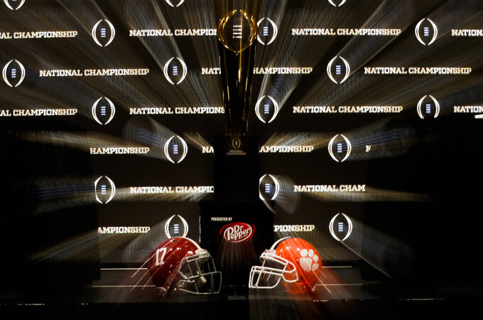 FILE - The championship trophy is seen before a news conference for the NCAA college football playoff championship game between Alabama and Clemson,  Sunday, Jan. 6, 2019, in Santa Clara, Calif. In a season of uncertainty, go with the sure things. Alabama vs. Clemson for the fourth time in the title game. (AP Photo/David J. Phillip, File)