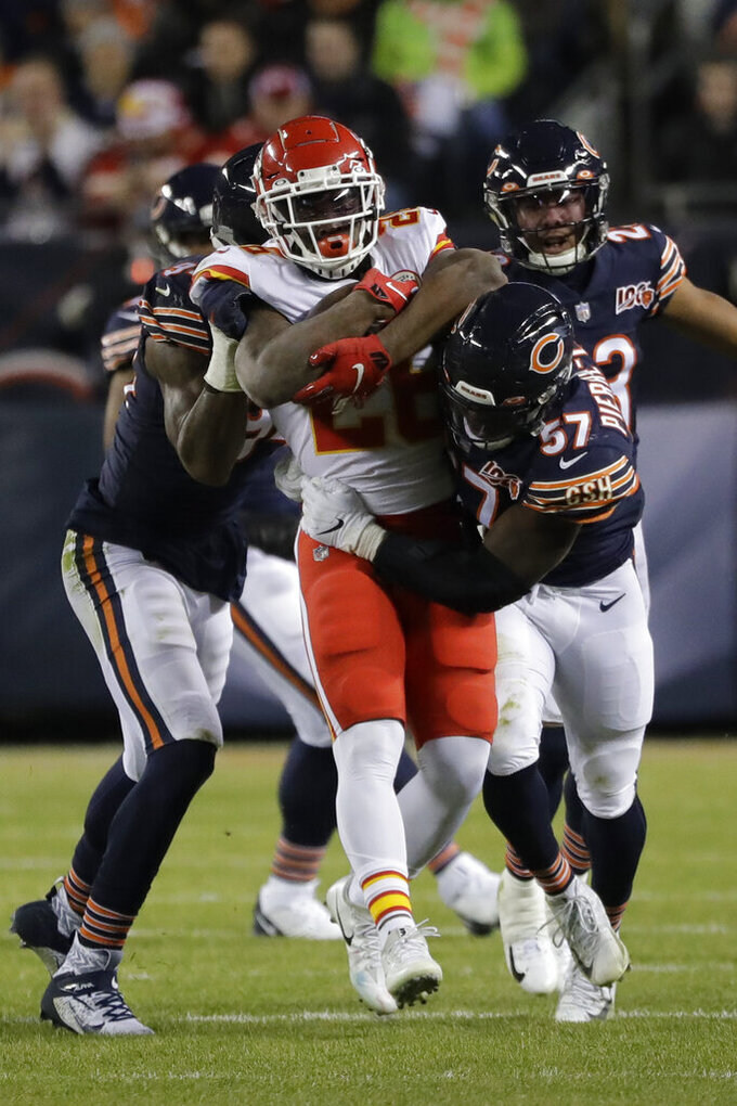 Chicago Bears linebacker Kevin Pierre-Louis (57) wraps up Kansas City Chiefs running back Damien Williams (26) in the first half of an NFL football game in Chicago, Sunday, Dec. 22, 2019. (AP Photo/Nam Y. Huh)