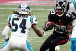 Atlanta Falcons running back Brian Hill (23) runs toward Carolina Panthers outside linebacker Shaq Thompson (54) during the first half of an NFL football game, Sunday, Oct. 11, 2020, in Atlanta. (AP Photo/Brynn Anderson)