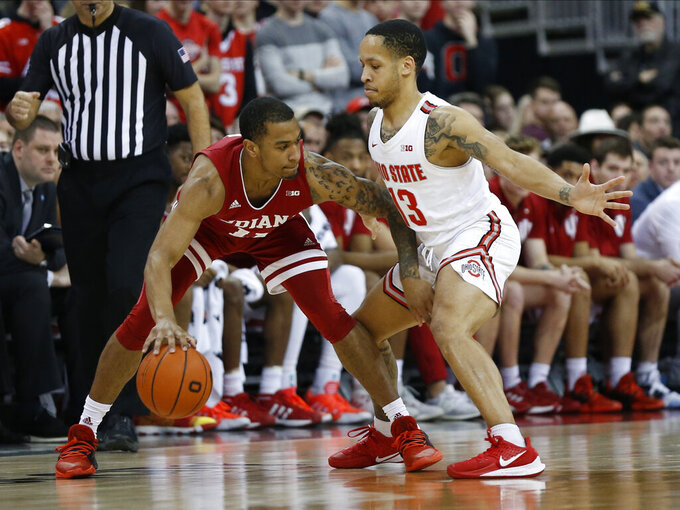 Indiana's Devonte Green, left, looks for an open pass as Ohio State's C.J. Walker defends during the second half of an NCAA college basketball game Saturday, Feb. 1, 2020, in Columbus, Ohio. Ohio State beat Indiana 68-59. (AP Photo/Jay LaPrete)