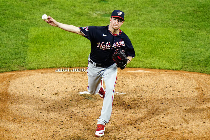Washington Nationals' Erick Fedde pitches during the third inning of a baseball game against the Philadelphia Phillies, Monday, Aug. 31, 2020, in Philadelphia. (AP Photo/Matt Slocum)