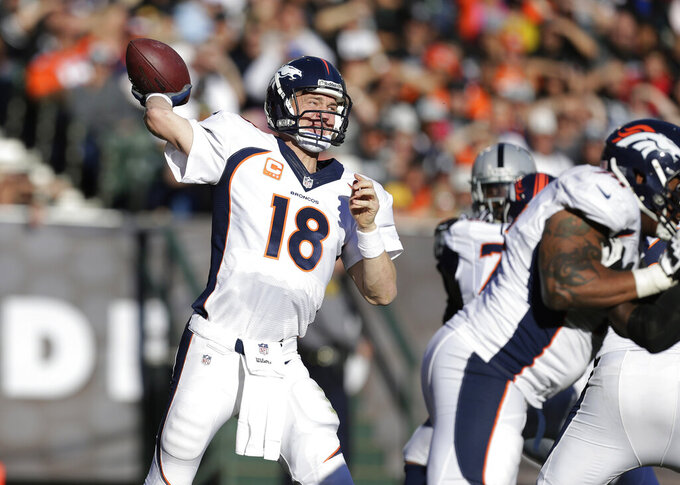 FILE - In this Dec. 29, 2013, file photo, Denver Broncos quarterback Peyton Manning (18) passes against the Oakland Raiders during the second quarter of an NFL football game in Oakland, Calif. With the NFL increasing its season to 17 games for the first change in length of the season since going from 14 to 16 games in 1978, some records and milestones, including Manning's mark of 5,477 yards in the 2013 season could soon be threatened by even more players. (AP Photo/Tony Avelar, File)