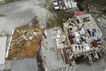 A damaged business is seen in the aftermath of Hurricane Sally, Thursday, Sept. 17, 2020, in Perdido Key, Fla. Rivers swollen by Hurricane Sally's rains threatened more misery for parts of the Florida Panhandle and south Alabama on Thursday, as the storm's remnants continued to dump heavy rains inland that spread the threat of flooding to Georgia and the Carolinas. (AP Photo/Angie Wang)