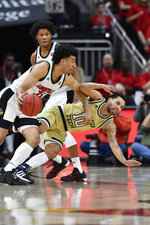 Georgia Tech guard Jose Alvarado (10) slips as he attempts to defend Louisville forward Jordan Nwora (33) during the first half of an NCAA college basketball game in Louisville, Ky., Wednesday, Jan. 22, 2020. (AP Photo/Timothy D. Easley)