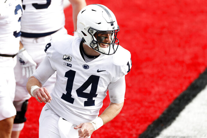 Penn State quarterback Sean Clifford reacts after a touchdown against Rutgers during the first half of an NCAA college football game Saturday, Dec. 5, 2020, in Piscataway, N.J. Penn St. won 23-7. (AP Photo/Adam Hunger)