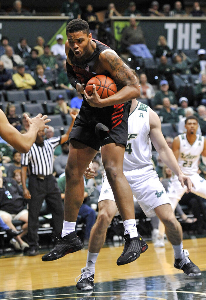 Houston South forward Braeon Brady pulls in a rebound during the first half of a NCAA college basketball game against South Florida, Saturday, Jan. 19, 2019 in Tampa, Fla. (AP Photo/Steve Nesius)
