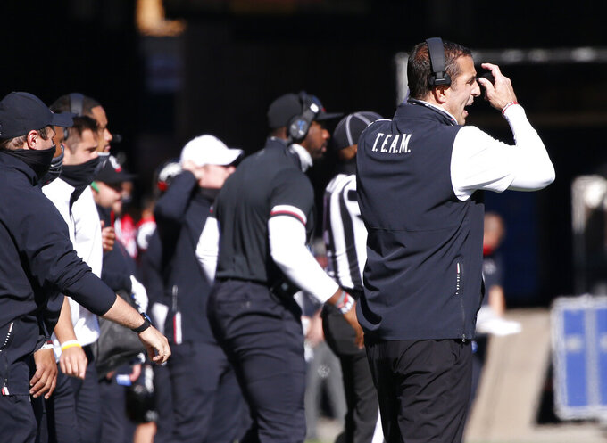 Cincinnati head coach Luke Fickell, right, reacts to a play against Memphis during the second half of an NCAA college football game Saturday, Oct. 31, 2020, in Cincinnati. (Photo by Gary Landers)