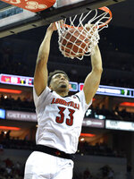 Louisville forward Jordan Nwora (33) dunks the ball during the second half of an NCAA college basketball game against Miami in Louisville, Ky., Sunday, Jan. 6, 2019. Louisville won 90-73. (AP Photo/Timothy D. Easley)