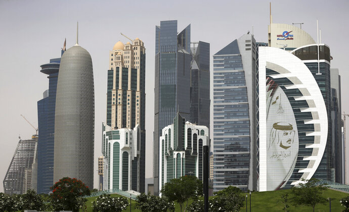 In this May 5, 2018 photo, a giant image of the Emir of Qatar Sheikh Tamim bin Hamad Al Thani, adorns a tower in Doha, Qatar. Kuwait's foreign ministry announced Monday, Jan. 4, 2021 that Saudi Arabia will open its air and land borders with Qatar in the first steps toward ending a diplomatic crisis that has deeply divided regional U.S. allies since 2017. (AP Photo/Kamran Jebreili)