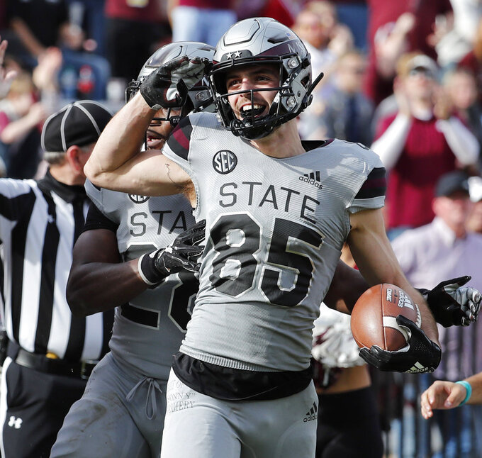 Mississippi State wide receiver Austin Williams (85) salutes after scoring a touchdown against Arkansas in the second half of an NCAA college football game in Starkville, Miss., Saturday, Nov. 17, 2018. Mississippi State won 52-6.(AP Photo/Rogelio V. Solis)