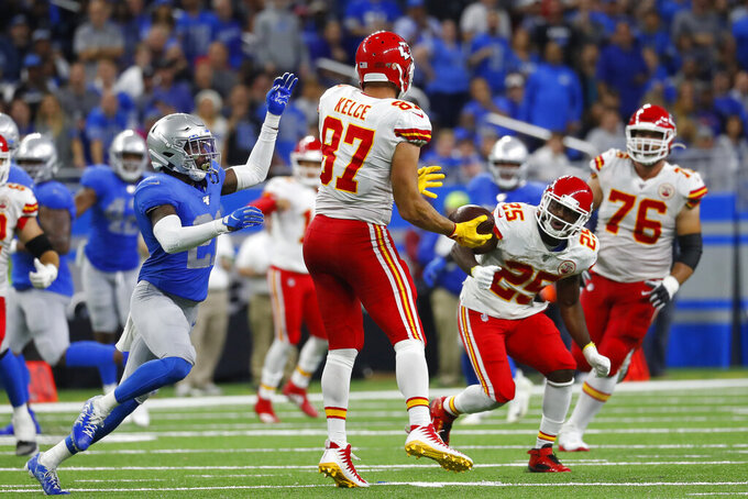 Kansas City Chiefs tight end Travis Kelce (87) laterals the ball to running back LeSean McCoy (25) during the second half of an NFL football game against the Detroit Lions, Sunday, Sept. 29, 2019, in Detroit. (AP Photo/Paul Sancya)