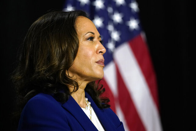Sen. Kamala Harris, D-Calif., listens as Democratic presidential candidate former Vice President Joe Biden introduces her as his running mate at Alexis Dupont High School in Wilmington, Del., Wednesday, Aug. 12, 2020. (AP Photo/Carolyn Kaster)