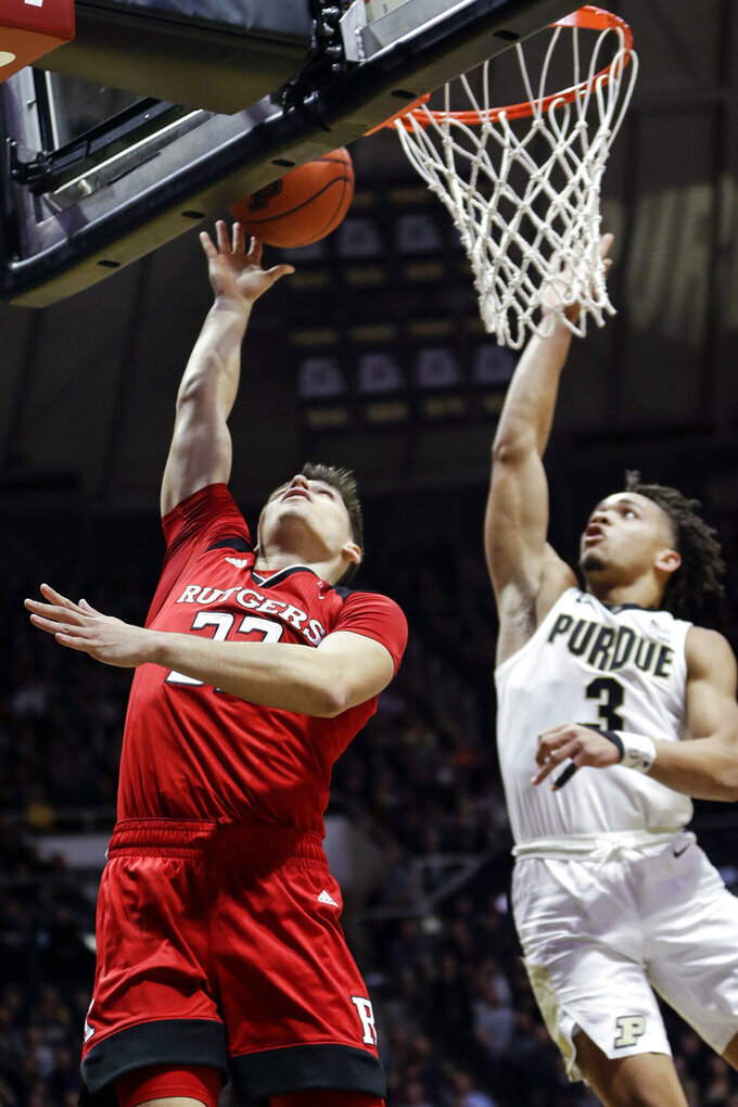 Rutgers guard Caleb McConnell, left, shoots in front of Purdue guard Carsen Edwards during the first half of an NCAA college basketball game in West Lafayette, Ind., Tuesday, Jan. 15, 2019. Edwards blocked the shot. (AP Photo/AJ Mast)