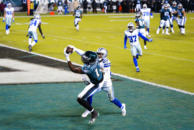 Philadelphia Eagles' Travis Fulgham (13) catches a touchdown pass against Dallas Cowboys' Trevon Diggs (27) during the second half of an NFL football game, Sunday, Nov. 1, 2020, in Philadelphia. (AP Photo/Chris Szagola)
