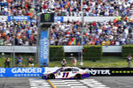 Denny Hamlin crosses the finish line to win a NASCAR Cup Series auto race, Sunday, July 28, 2019, in Long Pond, Pa. (AP Photo/Derik Hamilton)
