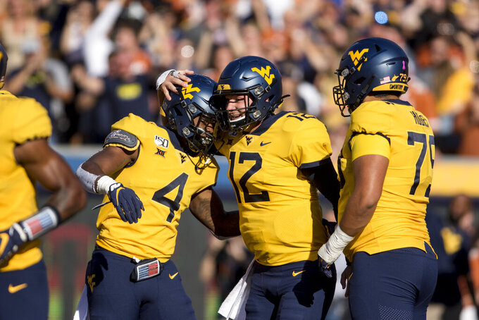 Teammates, coaches back WVU QB Kendall after 4-pick game