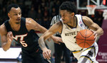 Notre Dame guard Prentiss Hubb (3) drives the ball against Virginia Tech guard Justin Robinson (5) during the first half of an NCAA college basketball game Tuesday, Jan. 1, 2019, in Blacksburg, Va. Va. Tech won 81-66. (AP Photo/Don Petersen)