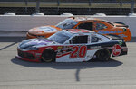 Christopher Bell, bottom, passes David Starr, top, early in the NASCAR Xfinity Series auto race, Saturday, July 27, 2019, at Iowa Speedway in Newton, Iowa. (AP Photo/Matthew Putney)