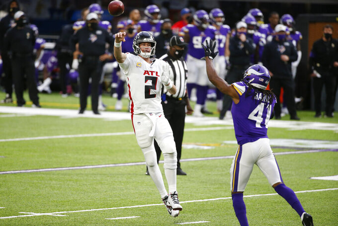 Atlanta Falcons quarterback Matt Ryan (2) throws a pass over Minnesota Vikings safety Anthony Harris (41) during the first half of an NFL football game, Sunday, Oct. 18, 2020, in Minneapolis. (AP Photo/Bruce Kluckhohn)
