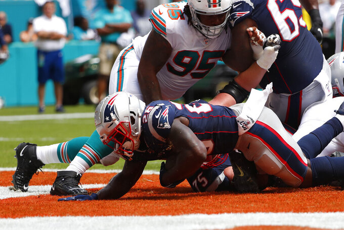 New England Patriots running back Sony Michel (26) scores a touchdown, during the first half at an NFL football game against the Miami Dolphins, Sunday, Sept. 15, 2019, in Miami Gardens, Fla. (AP Photo/Wilfredo Lee)