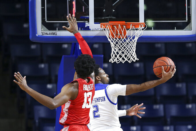 Tulsa's Keyshawn Embery-Simpson drives to the basket against Houston's J'Wan Roberts during the second half of an NCAA college basketball game in Tulsa, Okla., Tuesday, Dec. 29, 2020. Tulsa won 65-64. (AP Photo/Dave Crenshaw)