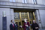 E. Jean Carroll, center, who says President Donald Trump raped her in the 1990s, speaks to reporters as she leaves the Daniel Patrick Moynihan United States Courthouse following a hearing in her defamation lawsuit against Trump, Wednesday, Oct. 21, 2020, in New York. A federal judge on Tuesday denied President Donald Trump's request that the United States replace him as the defendant in a defamation lawsuit alleging he raped a woman in a Manhattan department store in the 1990s. (AP Photo/John Minchillo)