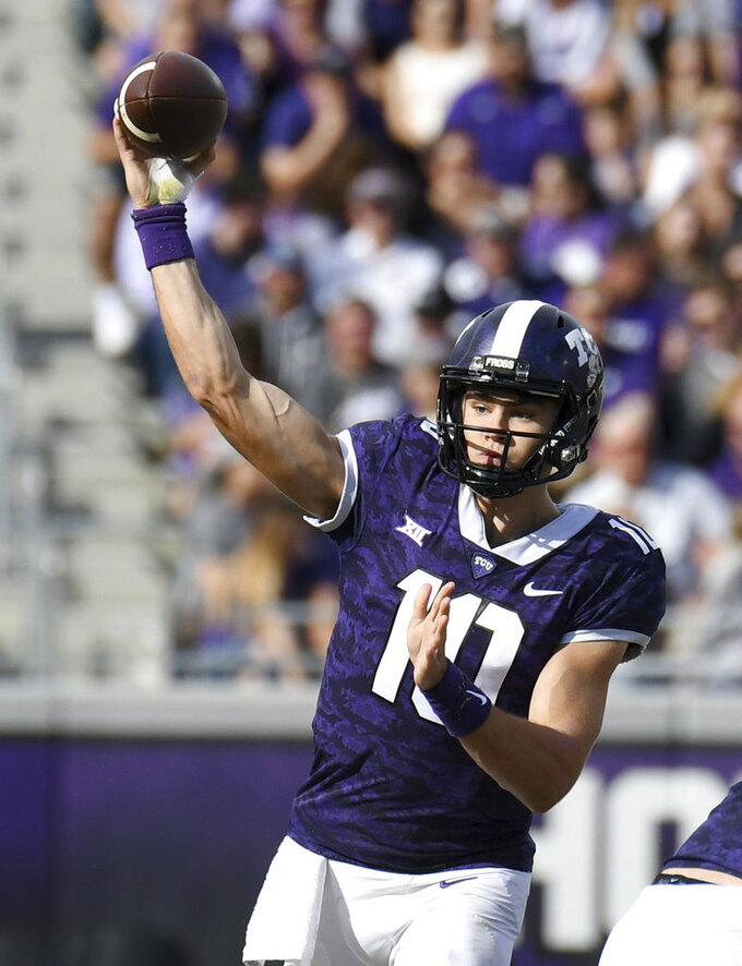 TCU quarterback Mike Collins, 10 throws downfield against Kansas State during the second quarter of an NCAA college football game Saturday, Nov. 3, 2018, in Fort Worth, Texas. (Bob Haynes/Star-Telegram via AP)