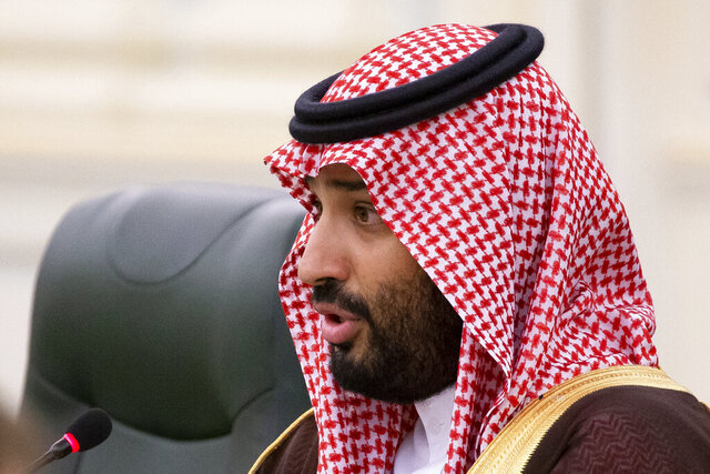 FILE - In this Oct. 14, 2019 file photo, Saudi Arabia's Crown Prince Mohammed bin Salman speaks to Russian President Vladimir Putin during the talks in Riyadh, Saudi Arabia.  United Nations experts Wednesday, Jan. 22, 2020 called for an