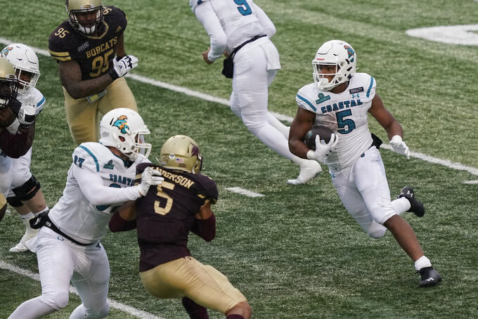 Coastal Carolina's Shermari Jones (5) runs against Texas State during the second half of an NCAA college football game in San Marcos, Texas, Saturday, Nov. 28, 2020. (AP Photo/Chuck Burton)