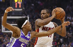 Miami Heat guard Dion Waiters, right, keeps the ball out of the reach of Sacramento Kings guard De'Aaron Fox during the first quarter of an NBA basketball game Friday, Feb. 8, 2019, in Sacramento, Calif. (AP Photo/Rich Pedroncelli)