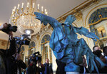 The rooster which plunged to the ground during the fire Notre Dame cathedral is displayed at the Culture Ministry in Paris, Friday, Sept. 20, 2019. The rooster, long a symbol of France, tumbled to the ground in the April blaze that consumed the cathedral's roof and collapsed its spire. The bird somehow survived, and is going on public display this weekend. (AP Photo/Michel Euler)