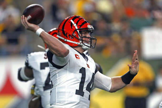 Cincinnati Bengals quarterback Andy Dalton (14) passes during the first half of an NFL football game against the Pittsburgh Steelers in Pittsburgh, Monday, Sept. 30, 2019. (AP Photo/Tom Puskar)