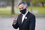 Former Cleveland Mayor and U.S. Rep. Dennis Kucinich gives a peace sign after voting, Tuesday, Sept. 14, 2021, in Cleveland. The Cleveland mayoral primary has seven candidates vying for the position. The top 2 from the mayoral primary will compete in the Nov. 2 general election. (AP Photo/Tony Dejak)